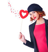 Beautiful girl with toy heart and abstract hearts around — Stock Photo