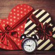 Retro clock and gift in heart shape on the background. — Stock Photo #38658563