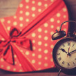 Retro clock and gift in heart shape on the background. — Stock Photo #38658589