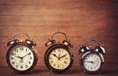Retro alarms clock on a table — Stok fotoğraf