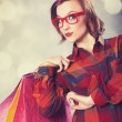 Stock Photo: Style girl with shopping bags.