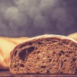 Delicious bread on wood table — Stock Photo #39266597