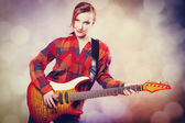 Fashion girl with guitar — Stock Photo