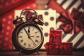 Vintage clock on christmas background. — Stock Photo