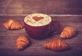 Cup of coffee with french croissants — Stock Photo