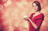 Beautyful redhead women with cup of tea. — Stock Photo