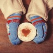 Hands in mittens holding hot cup of coffee — Stock Photo #39701385