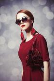 Beautiful redhead women with handybag. — Stock Photo