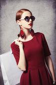 Beautiful redhead women with shopping bag — Stok fotoğraf