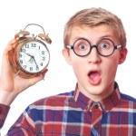 Nerd guy with alarm clock. — Stock Photo #40496217