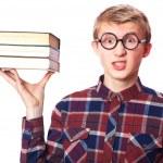 Nerd guy with books — Stock Photo #40496221