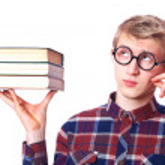 Nerd guy with books — Stock Photo