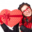 Gift in glasses with heart shape gift — Stock Photo #40496271