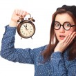 Brunette teen gift with alarm-clock. — Stock Photo #40496395