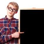 Nerd guy with blackboard. — Stock Photo