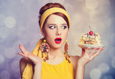 Style redhead girl with cake. — Stock Photo