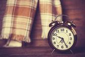 Alarm clock and scarf. — Stock Photo
