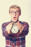 Nerd guy with alarm clock. — Stock Photo