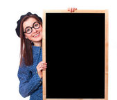 Brunette teen gift in glasses with blackboard. — Stock Photo
