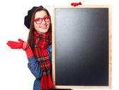 Brunette teen gift in glasses with blackboard. — Stock Photo