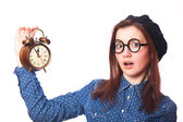 Brunette teen gift with alarm-clock. — Stock Photo