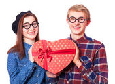Teen couple with heart shape gift. — Stock Photo