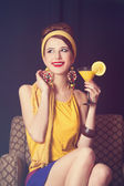 Redhead women sitting in the armchair with cocktail. — Stock Photo