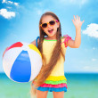 Little girl playing on beach with ball. — Stock Photo