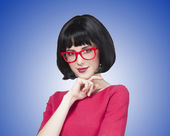 Brunette girl in glasses at  blue background.  — Foto Stock