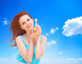 Redhead women with perfume at blue sky background. — Stock Photo