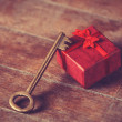 Retro key and little red gift — Stock Photo #42318525