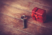 Retro key and little red gift — Foto Stock
