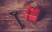 Retro key and little red gift — Stok fotoğraf