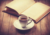 White cup of the coffee and vintage book. — Stock Photo