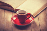 Red cup of the coffee and vintage book.  — Stock Photo
