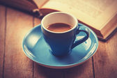 Blue cup of the coffee and vintage book. — Stock Photo
