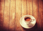 Little cup of the coffee on a wooden table — Stock Photo