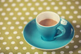Cup of a coffe on polka dot cover.  — ストック写真