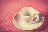 Cup of a coffee on polka dot cover.  — Foto de Stock