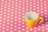 Cup of a coffe on polka dot cover — Стоковое фото