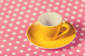 Cup of a coffe on polka dot cover — Foto de Stock