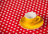 Cup of a coffe on polka dot cover — ストック写真
