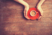 Female hands holding cup of coffee. — Stock Photo