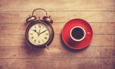 Alarm clock and cup of a coffee — Stock Photo