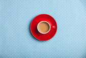 Cup of coffee on speckled background. — Stock Photo