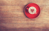 Cup of coffee on a wooden table. — Stock Photo