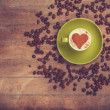 Cup of сoffee with shape heart on a wooden table. — Stock Photo