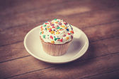 Cream cake with plate on a wooden table. — Stock Photo