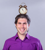 Handsome man with alarm clock  — Stock Photo