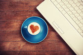 Cup of coffee with shape heart — Stock Photo